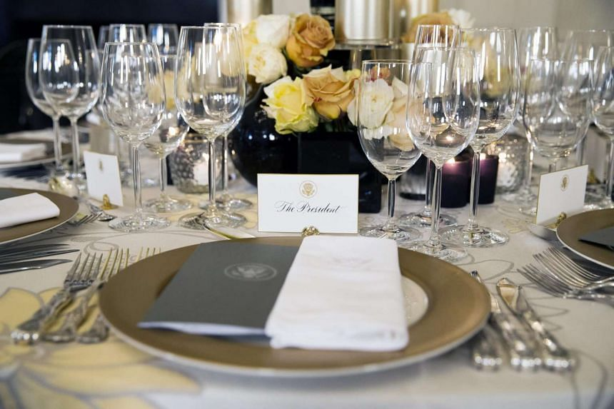 Examples of table settings are shown in the State Dining Room during a media preview for the upcoming State Dinner for the Prime Minister of Singapore, at the White House in Washington, DC, US, on July 29.