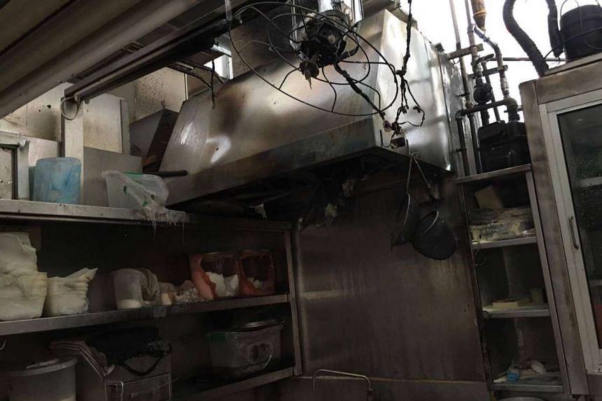 Investigations indicated that the fire was caused by repairs to the hawker stall's gas supply.