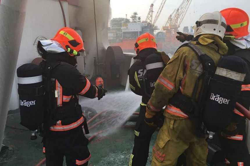 SCDF firefighters took about seven hours to bring the fire on the barge under control.