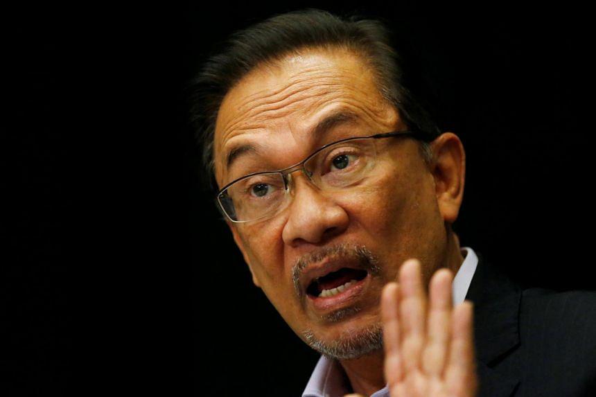 Malaysia's opposition leader Anwar Ibrahim speaks to the media in Kuala Lumpur on Feb 4, 2015.