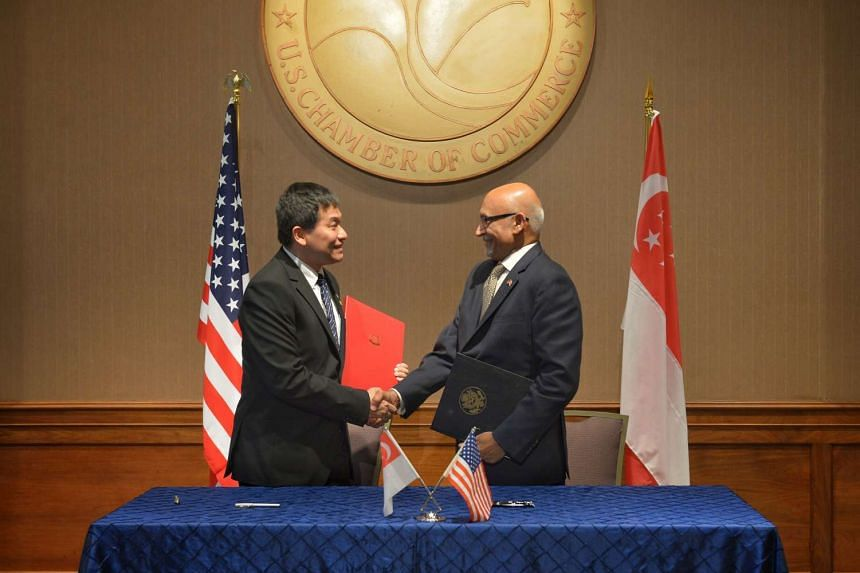 Mr Luke Goh (left), MTI's Deputy Secretary (Trade) and Mr Arun Kumar, Director General of the US and Foreign Commercial Service and Assistant Secretary for Global Markets. A MOU was signed to set up the Singapore-US Collaboration Platform.