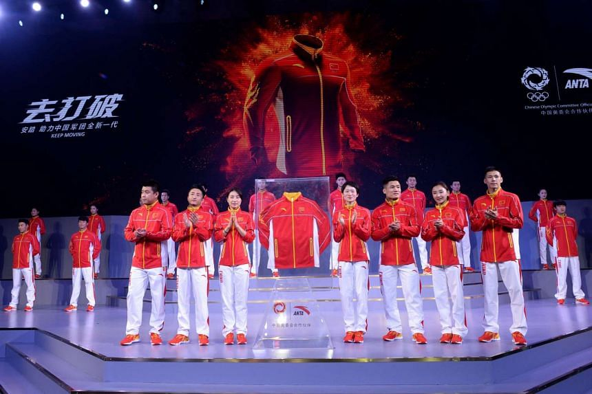 Athletes parading during a ceremony to unveil the Chinese Olympic team's uniforms for the Rio Games, in Beijing, on June 29, 2016.