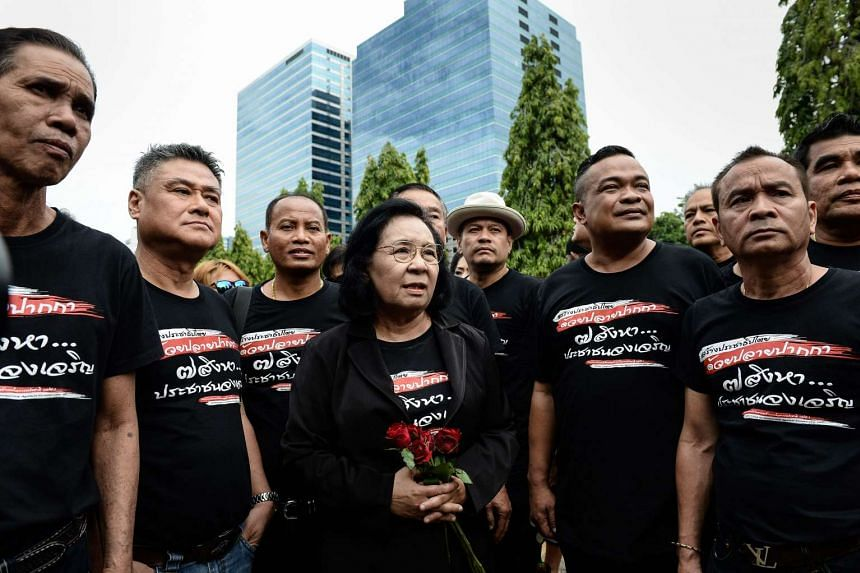 """Leaders of Thailand's pro-democracy """"Red Shirt"""" movement arrive at the Crime Suppression Division in Bangkok on August 2, 2016."""