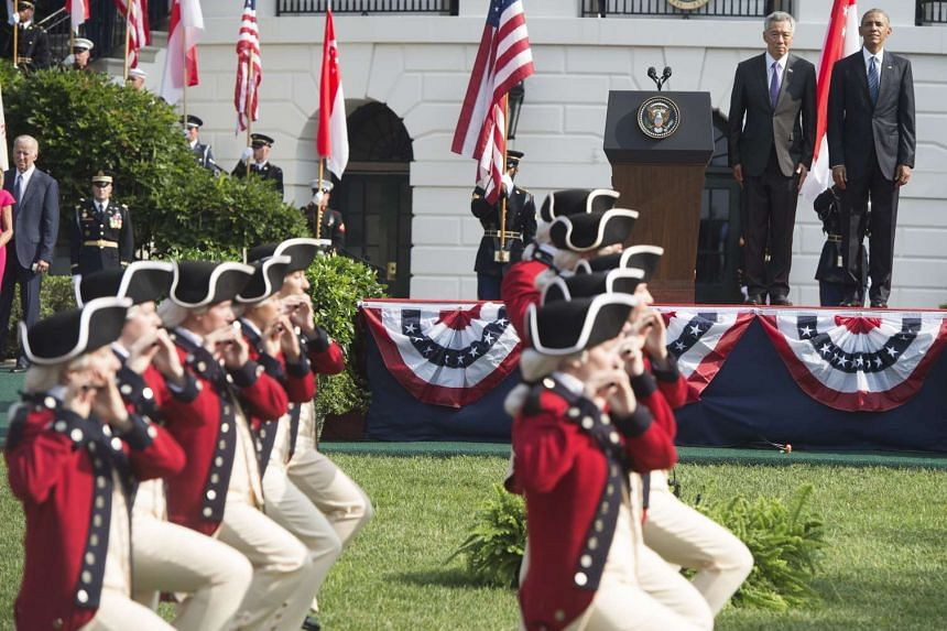 US President Barack Obama welcomes Singapore's Prime Minister Lee Hsien Loong with a State Arrival ceremony on the South Lawn of the White House in Washington, DC, Aug 2, 2016.