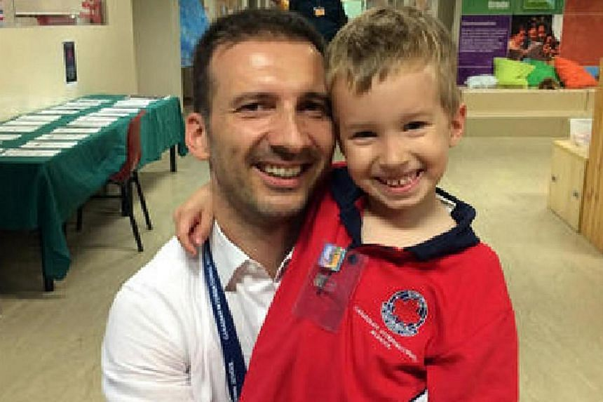 Mr Philippe Graffart with his son, Keryan, at the Canadian International School in August 2015.