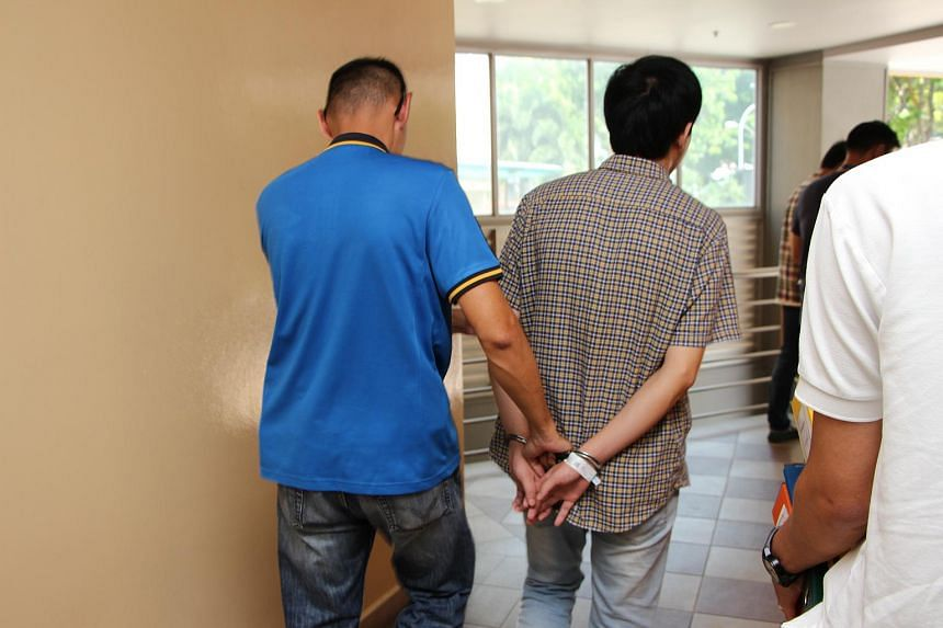 An arrested syndicate member being taken back for investigations.
