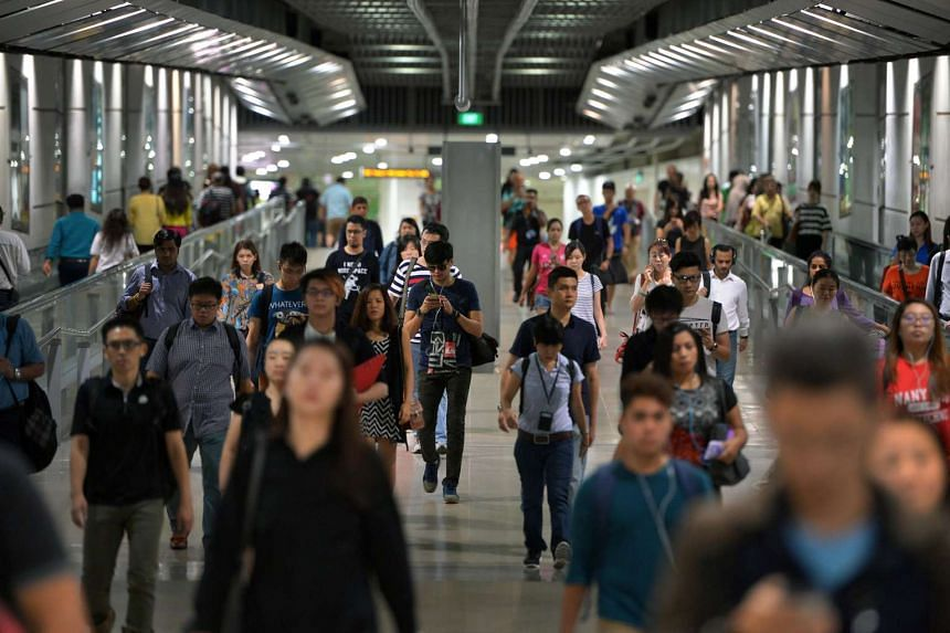 Commuters seen at Serangoon MRT station on July 29. Train and selected bus services will be extended on National Day eve (Aug 8), transport operators announced.