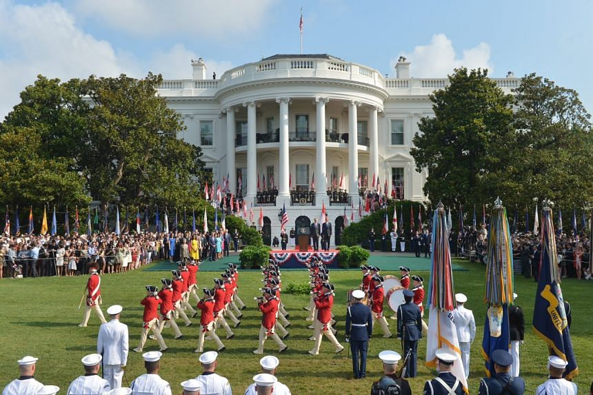 PM Lee Hsien Loong and US President Barack Obama watching the US Fife and Drums Corps during the welcome ceremony at the White House on Aug 2, 2016.