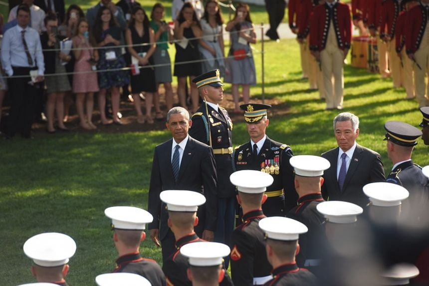PM Lee Hsien Loong inspecting the guard of honour with US President Barack Obama at the White House on Aug 2, 2016.