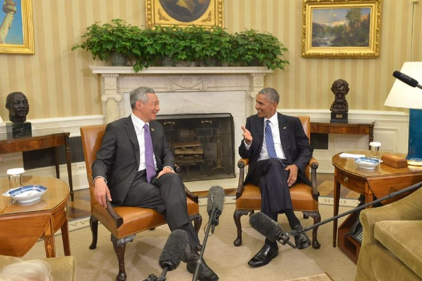 PM Lee Hsien Loong speaking with US President Barack Obama in the Oval Office during their bilateral meeting, on Aug 2, 2016.