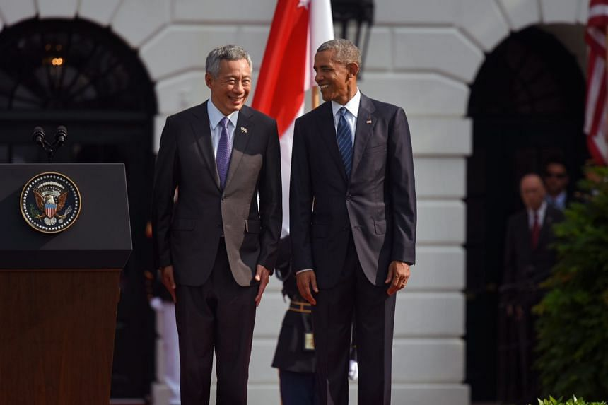 Prime Minister Lee Hsien Loong and US President Barack Obama sharing a joke at the welcome ceremony at the White House, on Aug 2, 2016.