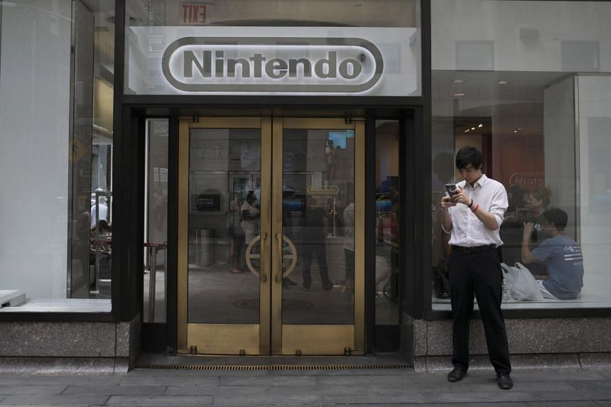A gamer plays Nintendo's Pokemon Go game outside the company's store at Rockefeller Center in New York on July 13.
