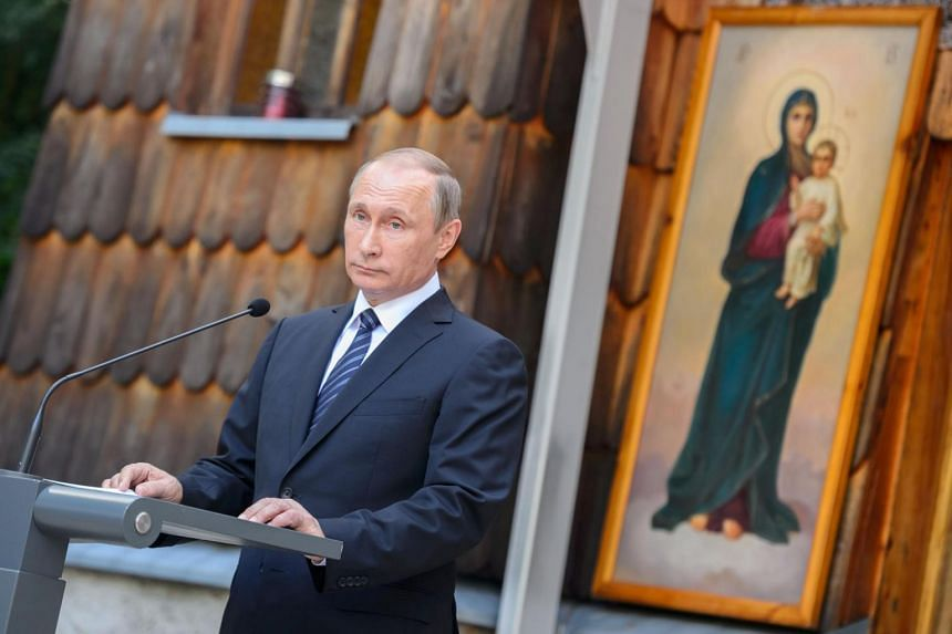 Russian President Vladimir Putin delivers a speech during a ceremony at a Russian Chapel at the Vrsic mountain pass in northern Slovenia.