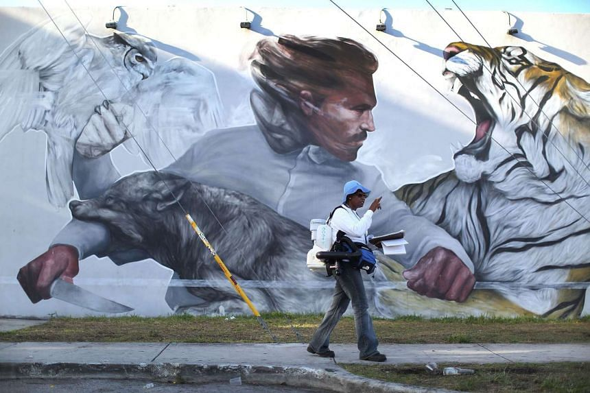 Miami-Dade County mosquito control inspector Sharon Nagel walks through the Wynwood neighborhood of  MIami as the county fights to control the Zika virus outbreak.