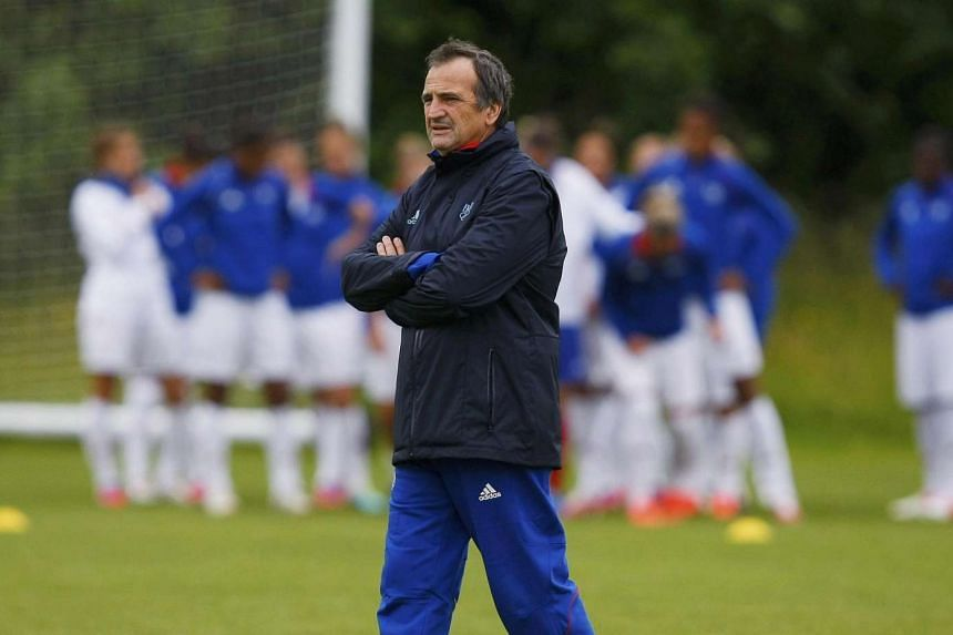 Bruno Bini, the head coach of the French women's Olympic soccer team, walks on the pitch during a training session ahead of the London 2012 Olympic Games, in Glasgow, Scotland July 22, 2012.