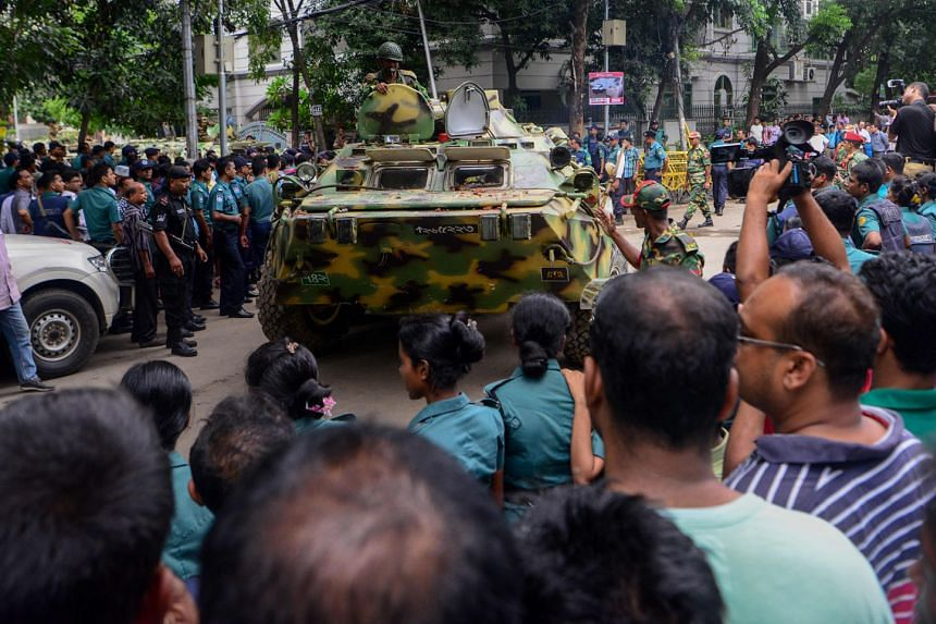 """A Bangladeshi armoured military tank in Dhaka on July 2, a day after the attack that killed 22 people in an upscale Dhaka restaurant. The Dhaka Tribune has reported that investigators suspect the militants who struck on July 1 were aided by """"several forei"""