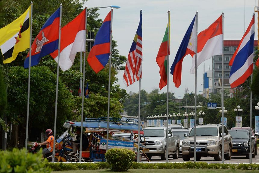 Asean countries' flags flying in Vientiane, Laos, as the country prepares for an economic ministers' meet. Economic cooperation among the 10 nations has the potential to deliver a more integrated and united Asean.