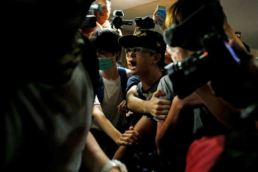 Supporters of Edward Leung try to break into the venue on Aug 2, 2016.