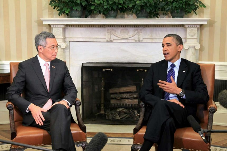 Prime Minister Lee Hsien Loong speaks with US President Barack Obama at a meeting in the White House's Oval Office on April 2, 2013.