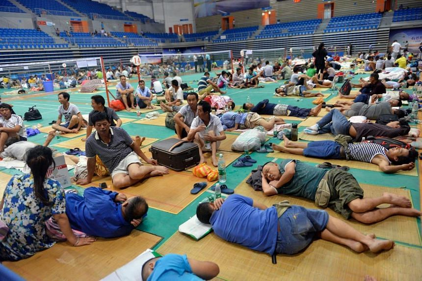 Chinese workers rest at Nansha Stadium as Typhoon Nida hit the area in Guangzhou, south China's Guangdong province, on Aug 2.