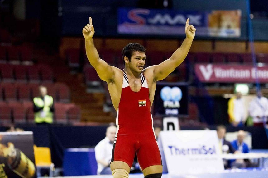 India wrestler Narsingh Pancham Yadav celebrates after winning the men's 74kg wrestling freestyle weight class during the Vantaa Cup 2012 Olympic qualifying tournament's finals in Vantaa.