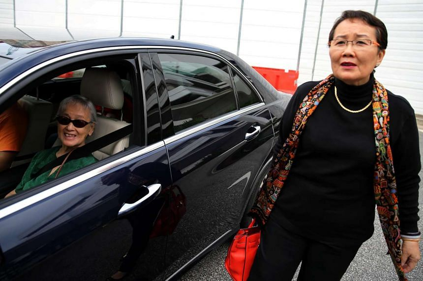 Madam Chung Khin Chun (left) and Hedy Mok arrive at the State Courts.