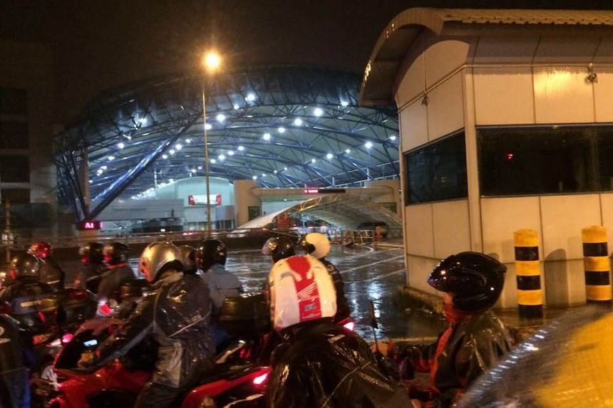 The two canopies fell due to strong winds and heavy rain, according to the Immigration & Checkpoint Authority.