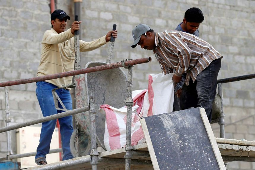 Asian labourers work at the construction site of a building in Riyadh, Saudi Arabia on Aug 2, 2016.