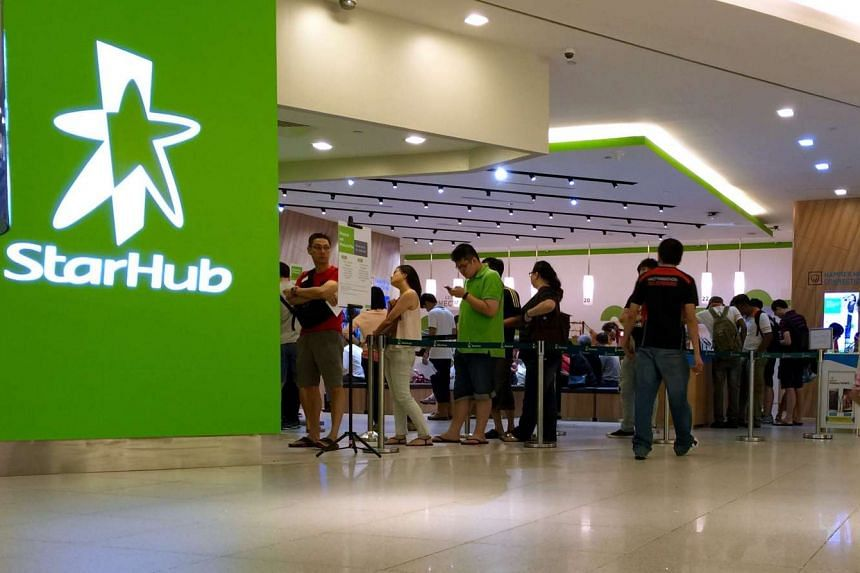 Customers at A StarHub retail outlet.