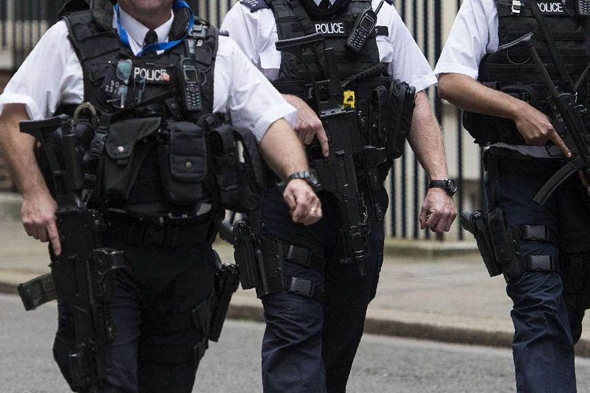 Armed British police officers patrolling near 10 Downing Street in London on July 15, 2016.