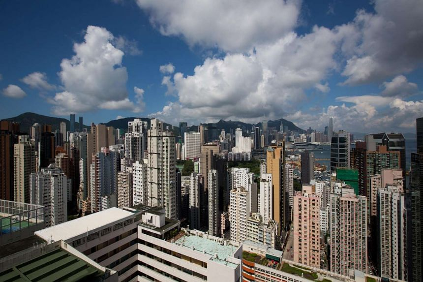 Commercial and residential buildings stand in Hong Kong, China, on July 21, 2016.