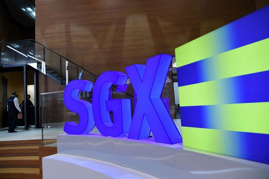 A security guard (left) walks past the auditorium of the Singapore Exchange (SGX) on July 27.