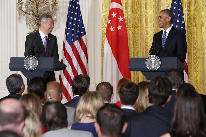 US President Barack Obama (right) and Prime Minister Lee Hsien Loong (left) participate in a joint press conference during the state visit in the East Room of the White House in Washington, DC, USA on Aug 2.
