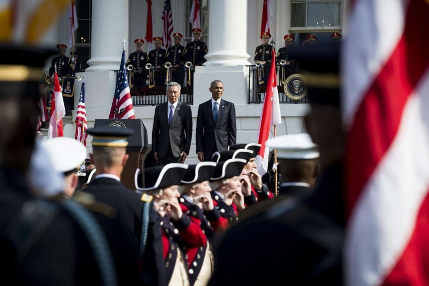 President Barack Obama (centre-right) and Prime Minister Lee Hsien Loong (centre-left) during official welcoming ceremonies on the South Lawn of the White House in Washington, DC, USA, on Aug 2.