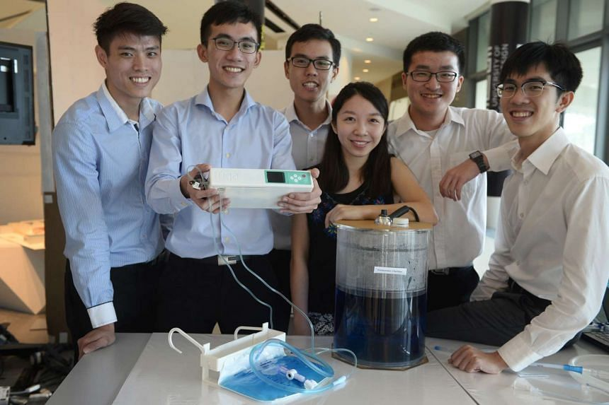 Singapore University of Technology and Design students with the Fuga Digital Chest Drain Device during the showcase of projects on Aug 3, 2016.