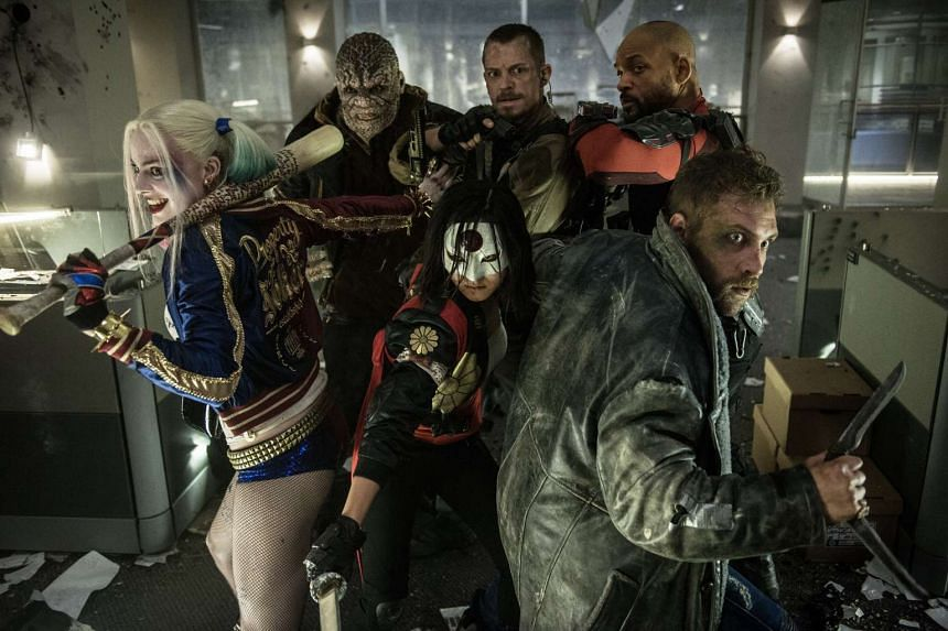 A cinema still from Suicide Squad, starring (clockwise, from bottom left), Margot Robbie, Adewale Akinnuoye-Agbaje, Joel Kinnaman, and Will Smith, Jai Courtney and Karen Fukuhama.