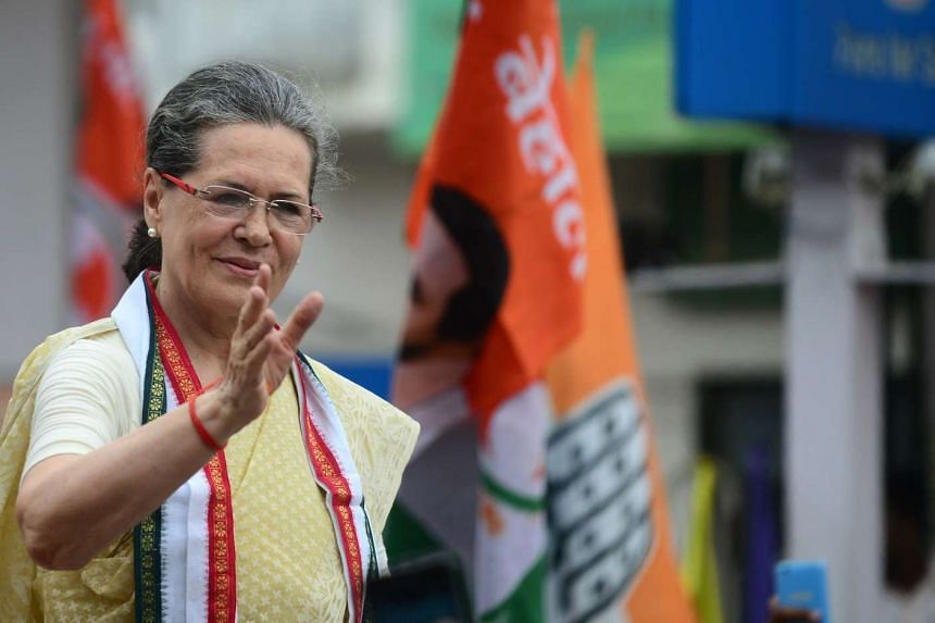 Indian Congress Party President Sonia Gandhi waving to supporters during a road show in Varanasi on Aug 2, 2016.