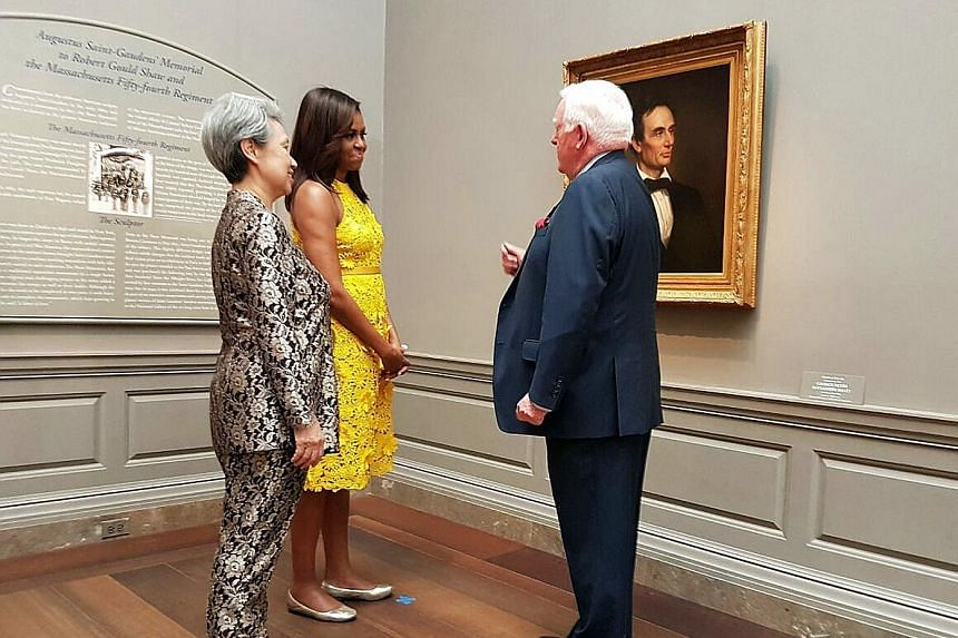Mrs Lee and Mrs Obama on a tour of the National Gallery of Art in Washington, DC. The painting here is a portrait of the 16th US president Abraham Lincoln, the last painted depiction of him without a beard. Mrs Lee, Mrs Obama and Mrs Vivian Balakrish