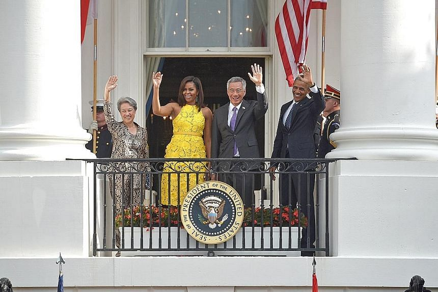 """PM Lee and Mr Obama greeting the crowd together with their wives at the White House yesterday. In his remarks, PM Lee noted that Singapore's ties with the US have withstood many political changes and remained steadfast, adding that """"we will maintain"""