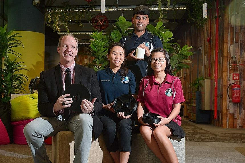 Mr Adam Gilmour, co-founder of home-grown start-up Gilmour Space Technologies, which successfully launched a self-made rocket in Australia two weeks ago. Mrs Gilmour (seated, centre) with design engineer Choo Pui Kim (right), 27, SUTD-MIT Internation
