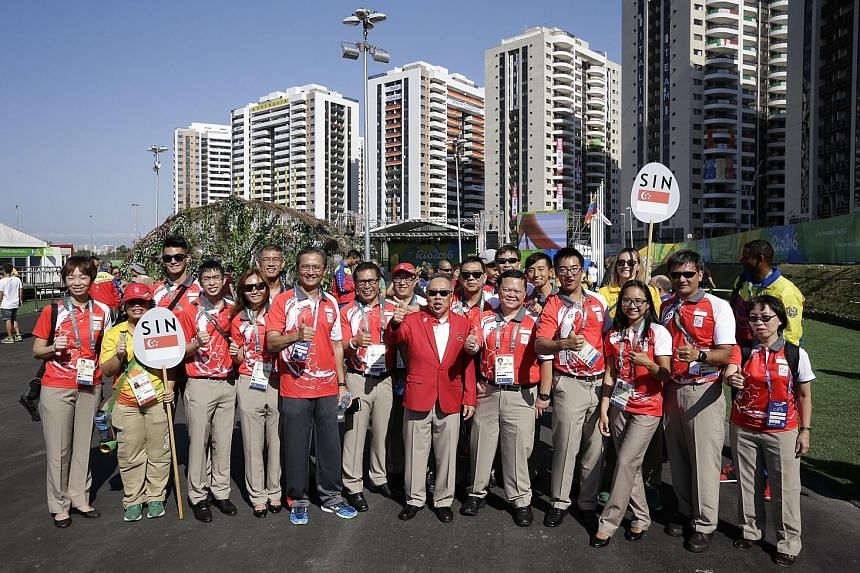 Chef de mission Low Teo Ping (centre, in red jacket) and some members of the 25-strong Singapore contingent at the Games Village in Rio de Janeiro, Brazil, yesterday after the welcome ceremony. Not all the Singapore athletes were present, as some wer