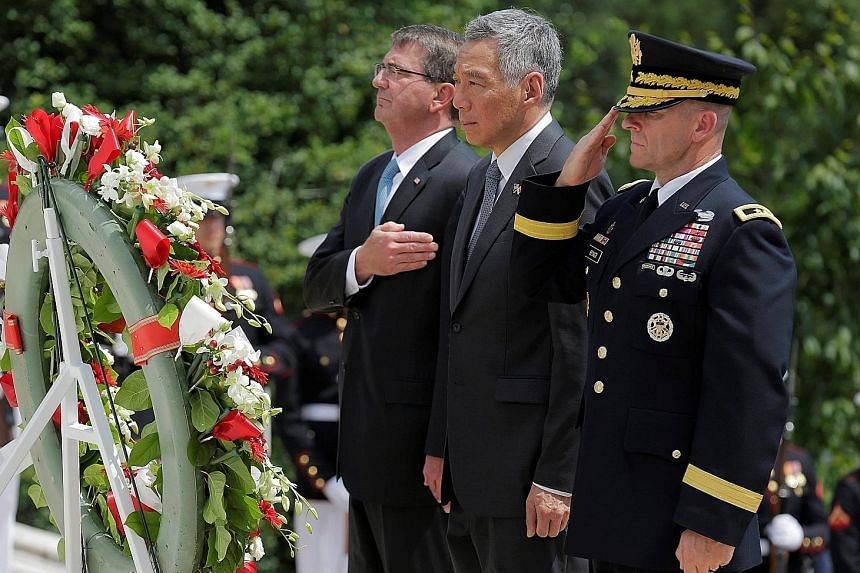 PM Lee, with US Defence Secretary Ash Carter (left) and US Army Major-General Bradley Becker, at the Tomb of the Unknown Soldier in Arlington National Cemetery on Monday.