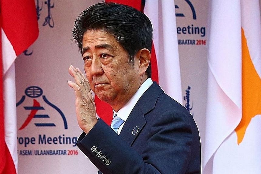 Japanese PM Shinzo Abe is seeking to expand Japan's economy by 20 per cent by 2020. A shopping area in the Japanese capital Tokyo. Prime Minister Abe has pledged measures to bolster household incomes, increase the birth rate and provide more care fac