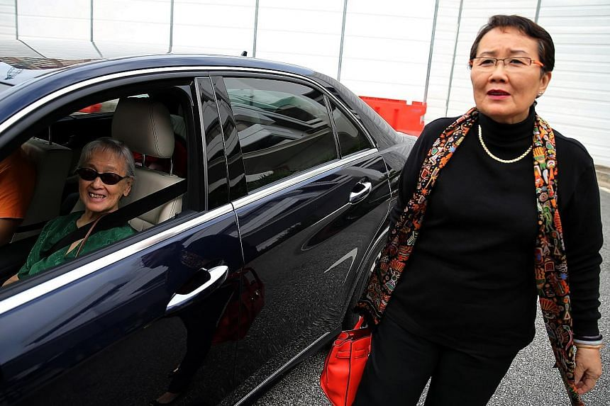 Madam Chung Khin Chun (left) and her niece Hedy Mok arriving at the State Courts yesterday. Madam Mok had sued Yang in 2014, claiming that he had unduly influenced her aunt, who was diagnosed with dementia that year.