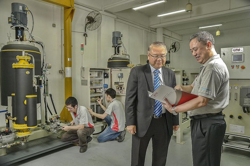 """Rim Polymers' executive vice-president Oei Han Tjing (centre) with technology director Lee Thiam Chye at Henderson Industrial Park. The firm entered Brazil and Mexico last year, and has identified the US as a """"promising market""""."""