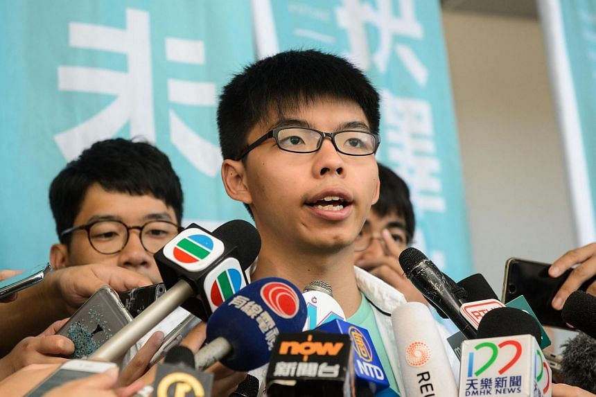 Pro-democracy political activist Joshua Wong, speaks to the media in Hong Kong on July 21, 2016.