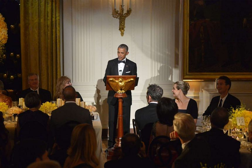 President Obama toasting during the state dinner at the White House on Aug 2.