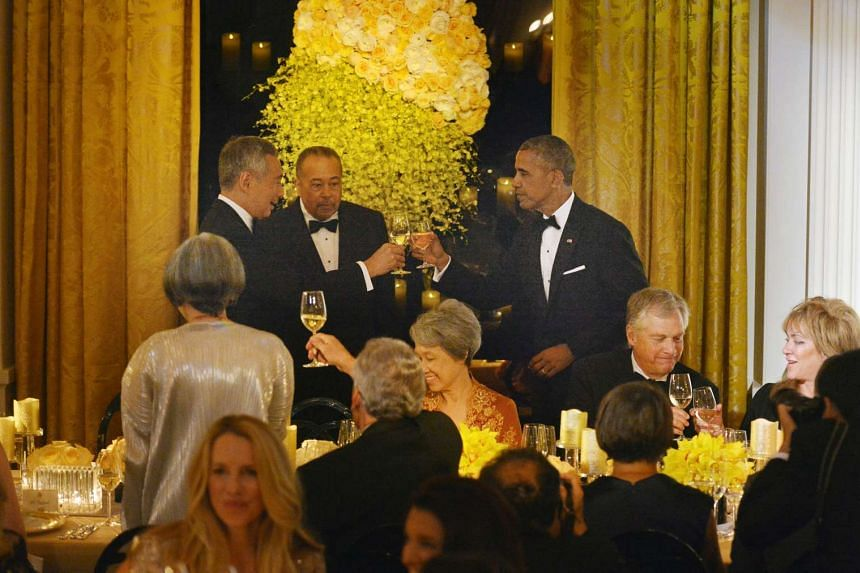 Mr Lee Hsien Loong and President Obama toasting during the state dinner at the White House on Aug 2.