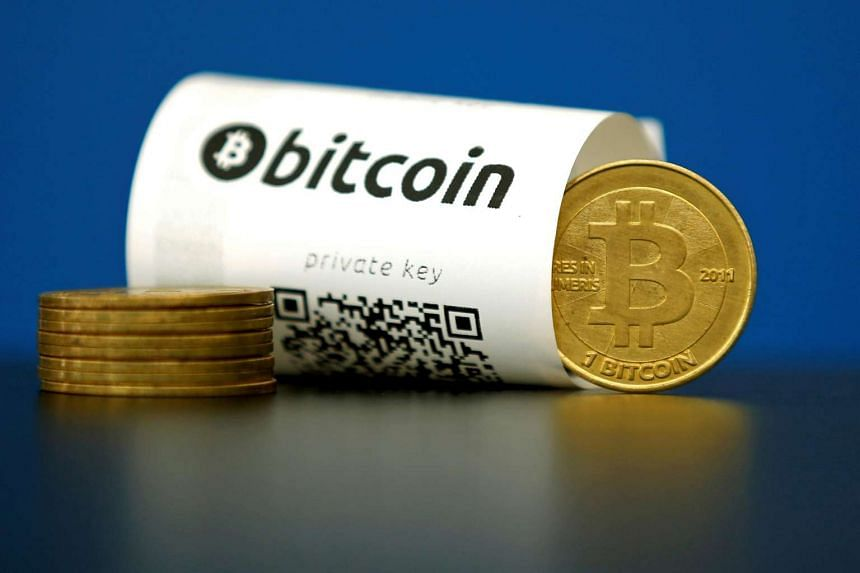 A bitcoin paper wallet with QR codes and a coin are seen in an illustration picture shot May 27, 2015.