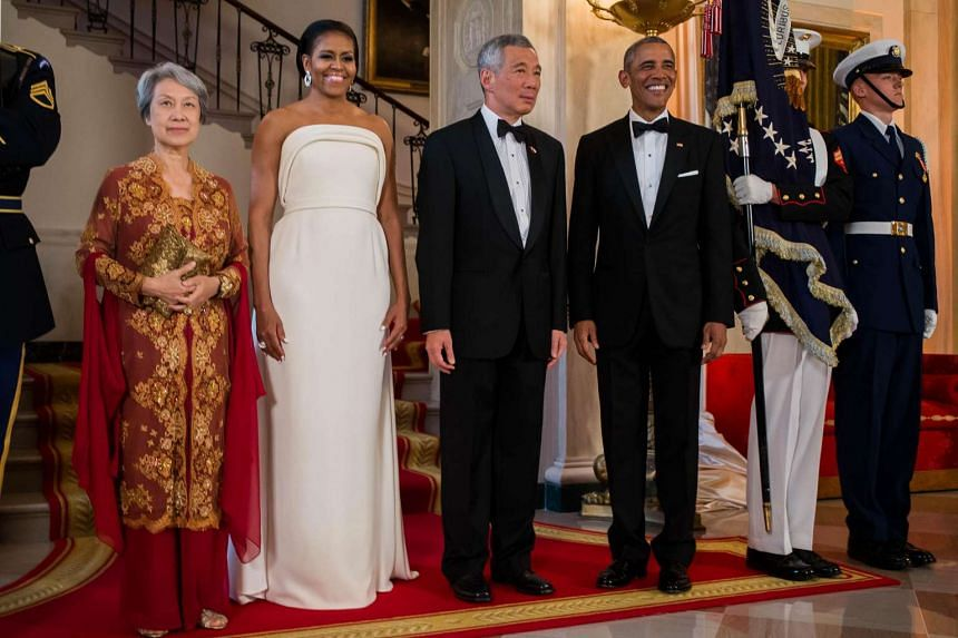 US President Barack Obama and First Lady Michelle Obama stand with Singapore Prime Minister Lee Hsien Loong and Mrs Lee before a state dinner at The White House on Aug 2, in Washington, District of Columbia.